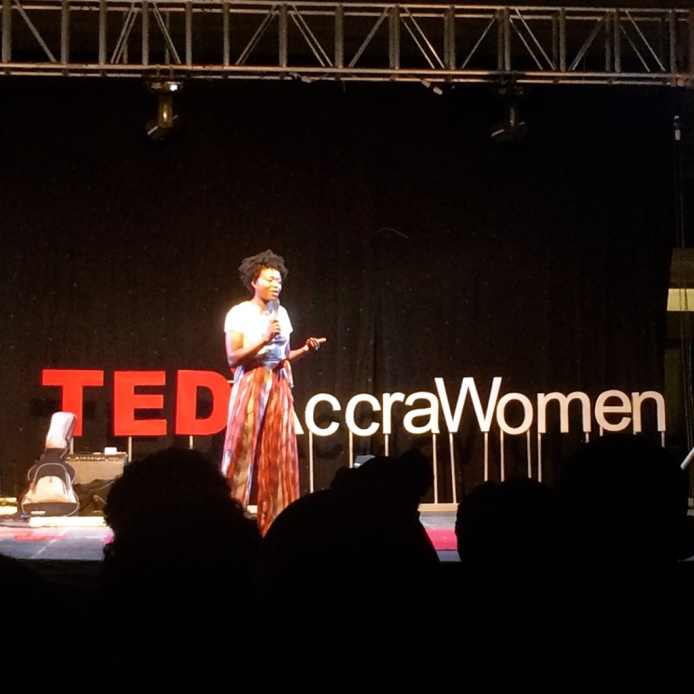The photo shows a woman on stage at the TED x Accra Women event