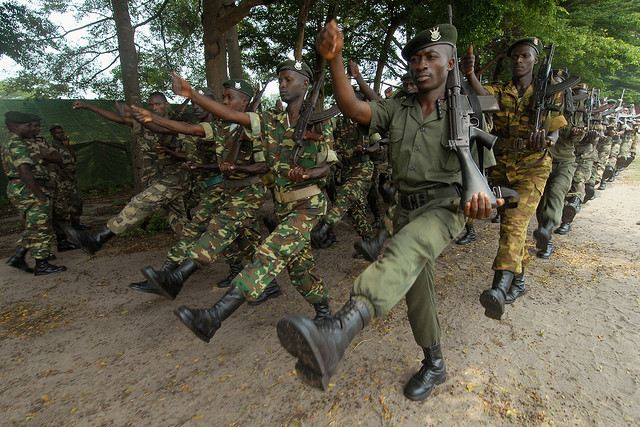 The photo shows members of the Burundian army marching in formation