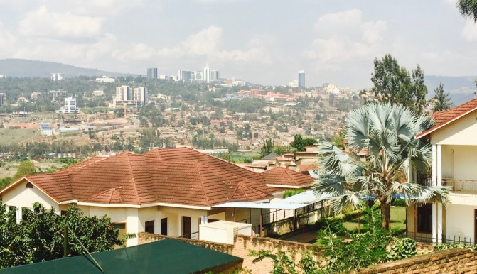 The photo shows a view of the hills in central Kigali