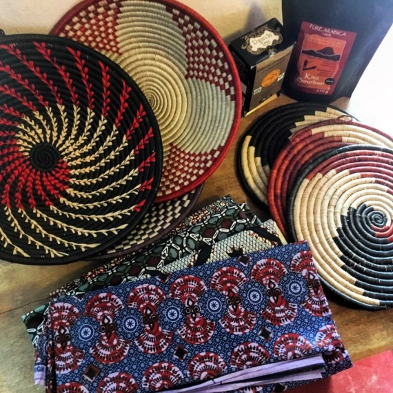 The photo shows three woven baskets, printed cloth, and Rwandan coffee and tea