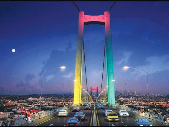 A large suspension bridge with yellow, red and green lights projected on it