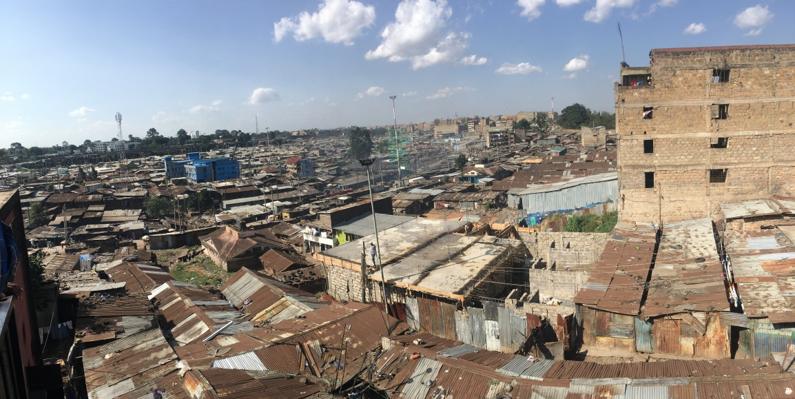 A panoramic photo showing the rusted tin roofs of the single-story buildings in Mathare