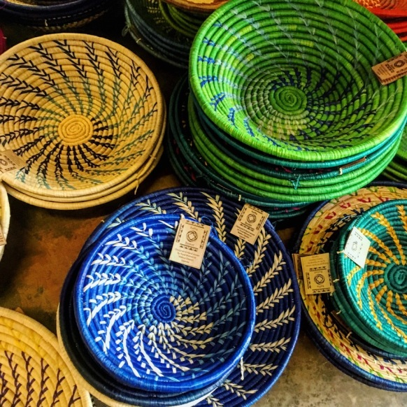 Shallow woven baskets in blue, green and yellow
