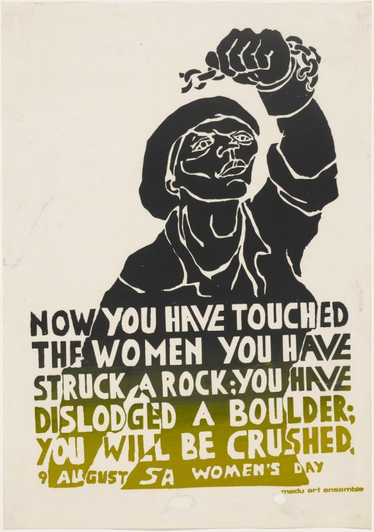 "Black and yellow print showing a woman with her fist upraised, and a slogan at the bottom reading ""Now you have touched the woman you have struck a rock; you have dislodged a boulder; you will be crushed.  9 August SA Women's Day"""