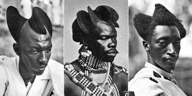 Three Rwandan men with their hair shaped into swooping, curved figures