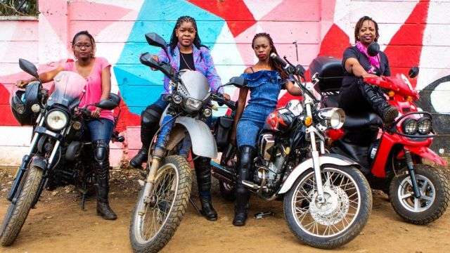 Four Kenyan women on motorcycles