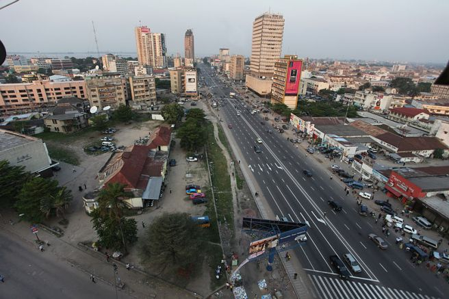 Downtown Kinshasa, showing a few fall buildings over surprisingly empty streets