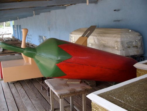 A coffin shaped like a chili pepper